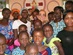 The late Spanish Salesian priest Antonio Cesar Fernandez (back, 3rd from R) appears in this 2015 picture taken in Korhogo, Ivory Coast.  By - (SALESIANS OF DON BOSCO ORDER/AFP)