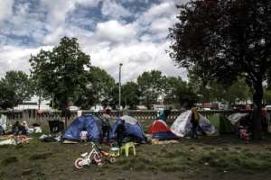 The makeshift camps are regularly cleared by French authorities, but migrants quickly return to the medians and overpasses on Paris motorways. By Christophe ARCHAMBAULT (AFP)