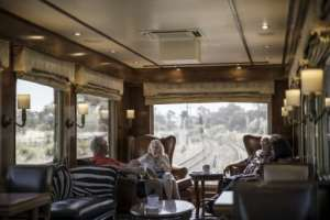 The massive windows of the observation car offer views of the landscapes and cityscapes along the Blue Train's route.  By MARCO LONGARI (AFP)