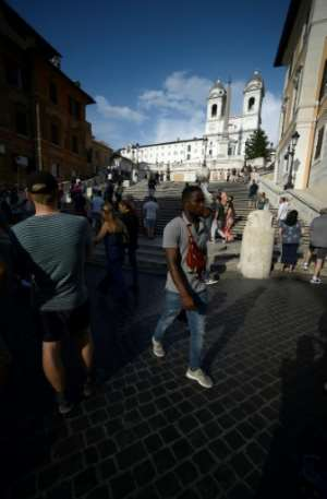 The migrants hand out audio guides and lead walking tours in English and Italian.  By Filippo MONTEFORTE (AFP)