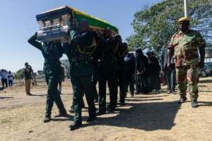 The Mugabe family opted to bury Zimbabwe's founding father in Kutama after disputing with the government.  By Jekesai NJIKIZANA (AFP)