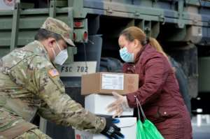 The National Guard delivers food to some communities hardest hit by the coronavirus pandemic in Chelsea, Massachusetts.  By Joseph Prezioso (AFP)