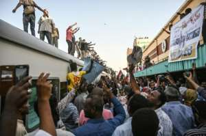 The scene at Bahari station in Khartoum on Tuesday, after the train full of protesters arrived from Atbara. By OZAN KOSE (AFP)