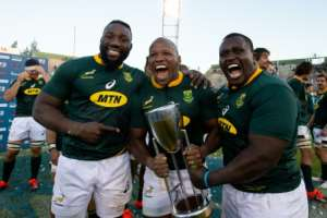 The Springbok front row of Tendai Mtawarira (L), Bongi Mbonambi and Trevor Nyakane celebrate winning the Rugby Championship in Argentina.  By Juan GASPARINI (AFP)