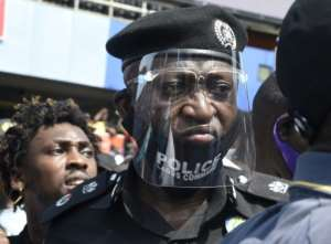 The police chief of Nigeria's economic hub looks on at protesters demonstrating against police brutality.  By PIUS UTOMI EKPEI (AFP)
