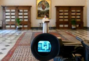 The pope delivered his Easter addresses via video livestream, a first for the pontiff.  By Handout (VATICAN MEDIA/AFP)