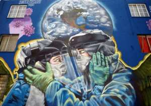 The pandemic is gaining ground in Latin America, including in Mexico where this mural was painted.  By ALFREDO ESTRELLA (AFP)