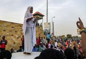 The protest movement's 'Nubian queen', Alaa Salah, has been propelled to internet fame after clips went viral of her leading chants against President Omar al-Bashir.  By - (AFP)