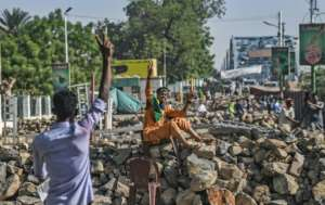 The protesters have thrown up barricades around their sit-in but Sudan's military rulers have vowed repatedly they will not resort to force to disperse them. By OZAN KOSE (AFP/File)