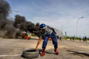 The protests were met with a ruthless response from the army and police.  By Zinyange AUNTONY (AFP)