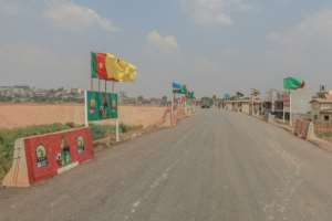 The roads are quiet as the African Nations Championship flags flutter in the breeze.  By Daniel BELOUMOU OLOMO (AFP)