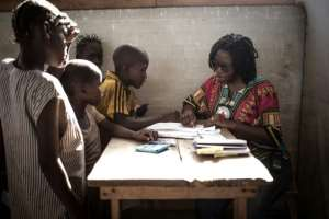 The Red Cross programme has enabled psychologist Mamie Nouria Meniko to identify 233 children aged five to 15 who bear symptoms of PTSD..  By FLORENT VERGNES (AFP)