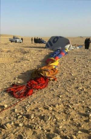 The remains of a hot air balloon are seen on the ground near the ancient city of Luxor after a fatal crash on January 5, 2018