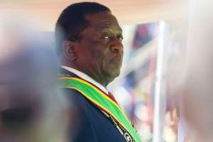 The ruling ZANU-PF party, which has held power since independence in 1980, easily won the parliamentary vote on July 30, 2018, while President Emmerson Mnangagwa (pictured August 2018) won the presidency with just over 50 percent of the vote.  By Jekesai NJIKIZANA (AFP/File)