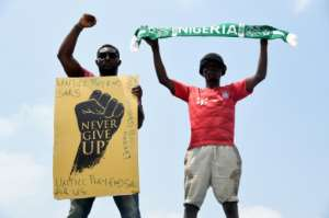 The wave of protests in Nigeria has rattled the authorities as the biggest show of people power in years has turned into demands from youths for sweeping changes .  By PIUS UTOMI EKPEI (AFP)
