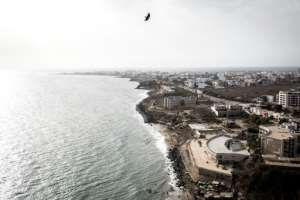 The West African metropolis of some three million people is situated on a peninsula that juts into the Atlantic.  By JOHN WESSELS (AFP)