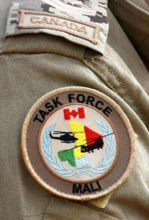 The uniform patch on the shoulder of a Canadian soldier with the United Nations Multidimensional Integrated Stabilization Mission in Mali (MINUSMA).  By SEYLLOU (AFP/File)