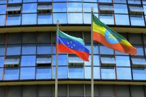 The unofficial green, blue and red Sidama flag, left, has been fluttering over government buildings ahead of the expected declaration of the new state.  By Michael TEWELDE (AFP)