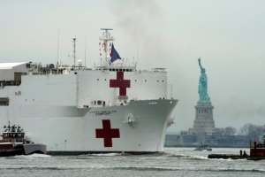 The USNS Comfort medical ship moves up the Hudson River past the Statue of Liberty as it arrives in New York.  By Bryan R. Smith (AFP)