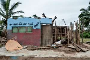 The village's Impala Salao de Cha tea room was destroyed in the storm. By Emidio JOSINE (AFP)