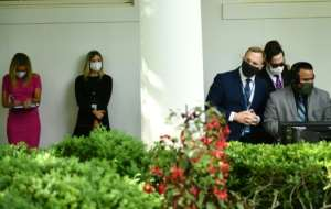The virus appeared to have gained a foothold in the White House over the weekend, with staff told they had to wear masks at work.  By Brendan Smialowski (AFP)