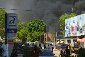 Thick smoke rose from the centre of Ouagadougou as the attacks unfolded.  By Ahmed OUOBA (AFP)