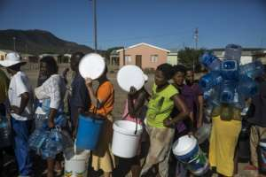 Thirst: People stand in line for water in Bezuidenhoutville township.  By Guillem Sartorio (AFP)