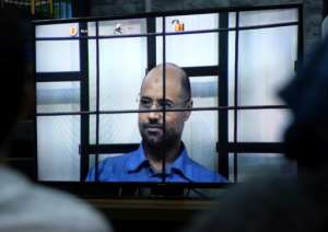 This file photo taken in Tripoli on April 27, 2014 shows Seif al-Islam, the son of slain Libyan dictator Moamer Kadhafi, answering judges' questions during a live broadcast from the town of Zintan