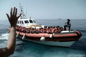 This handout picture from Medecins Sans Frontieres shows rescued migrants onboard an Italian coastguard ship following their transfer from the French NGO's ship Aquarius.  By Karpov (MSF/SOS MEDITERRANEE/AFP)