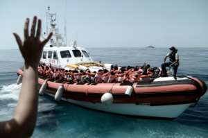 This handout picture from Medecins Sans Frontiers shows rescued migrants onboard an Italian coastguard ship following their transfer from the French NGO's ship Aquarius.  By Karpov (MSF/SOS MEDITERRANEE/AFP)