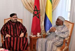 This handout picture provided by the Moroccan Royal Palace on December 3, 2018 shows Morocco's King Mohamed VI (L) visiting Gabon's President Ali Bongo at the military hospital in the capital Rabat..  By Handout (Moroccan Royal Palace/AFP)