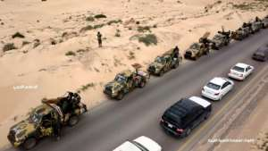 This image grab obtained from a video posted April 3, 2019 on the Facebook page of Libyan strongman Khalifa Haftar's self-proclaimed Libyan National Army War Information Division allegedly shows military convoys heading towards the capital Tripoli. By - (LNA War Information Division/AFP/File)