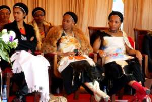 Three of King Mswati III's wives look at their husband as he delivers a speech calling on men to get circumcised. By Jinty Jackson (AFP/File)