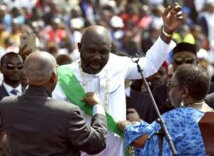Tim Weah's father, George, was sworn as Liberia's president in January.  By ISSOUF SANOGO (AFP/File)