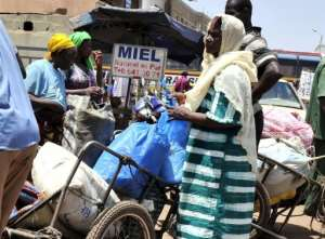 People arrive in Bamako from the northern city of Timbuktu on April 4.  By Issouf Sanogo (AFP/File)