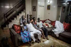 Time for TV: The Sarkin Fulani relaxes with his family.  By Luis TATO (AFP)