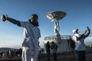 Time for a selfie: People take pictures in front of a radio dish during the satellite launch.  By EDUARDO SOTERAS (AFP)