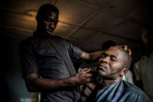 Time for a trim: Ibrahim goes to a barber's shop, one of numerous businesses that have sprung up on the reserve.  By Luis TATO (AFP)