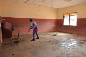 Time to clean: A student readies a classroom at an Accra school.  By Nipah Dennis (AFP)