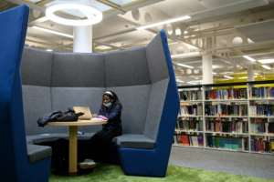 To study in Coventry University's library, students must reserve a place under virus measures.  By OLI SCARFF (AFP)