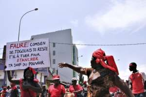Togo's government is reeling from popular protests, which have seen tens of thousands of people take to the streets calling for President Faure Gnassingbe's resignation.  By MATTEO FRASCHINI KOFFI (AFP/File)