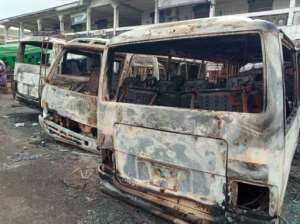 Torched: Vehicles at Buea bus terminal after clashes in July 2018.  By - (AFP)