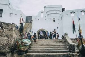 Tourists visit the 'Door of No Reutrn' at Cape Coast Castle in Ghana where enslaved Africans were loaded onto ships to the Americas.  By NATALIJA GORMALOVA (AFP)