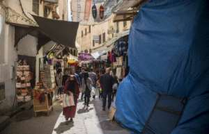 Tourists and locals walk in the medina in Fez, listed as a UNESCO World Heritage Site in 1981 for its