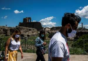 Tourism is starting to creep back in some countries, even hard-hit Italy which reopened Pompeii this week.  By Tiziana FABI (AFP)