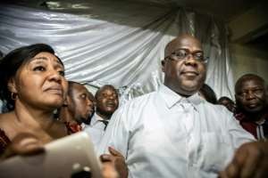 Tshisekedi, surrounded by his wife, relatives and supporters, shortly after the national election commission declared him winner of the December 30 ballot.  By Caroline Thirion (AFP)