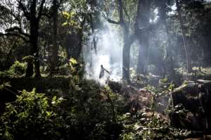 Troops walk through a newly-captured enemy position in Wago Forest.  By John WESSELS (AFP)