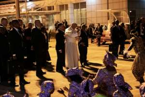 Traditional dancers greeted the pope on his his arrival at Maputo International Airport.  By GIANLUIGI GUERCIA (AFP)