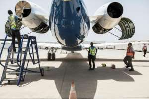 Transair's ground crew prepare a twin-jet Embraer for a one-hour technical flight, one of the few exceptions allowed under Senegal's anti-coronavirus restrictions.  By JOHN WESSELS (AFP)