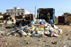 Trash collection in greater Dakar is the responsibility of public authorities. But not all households are serviced by solid waste collection trucks.  By Seyllou (AFP)